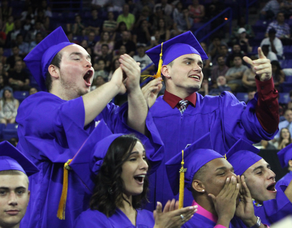 . Greater Lowell Tech graduation. Shawn Maguire, left, and Matthew McNulty, both of Lowell, cheer a friend. (SUN/Julia Malakie)