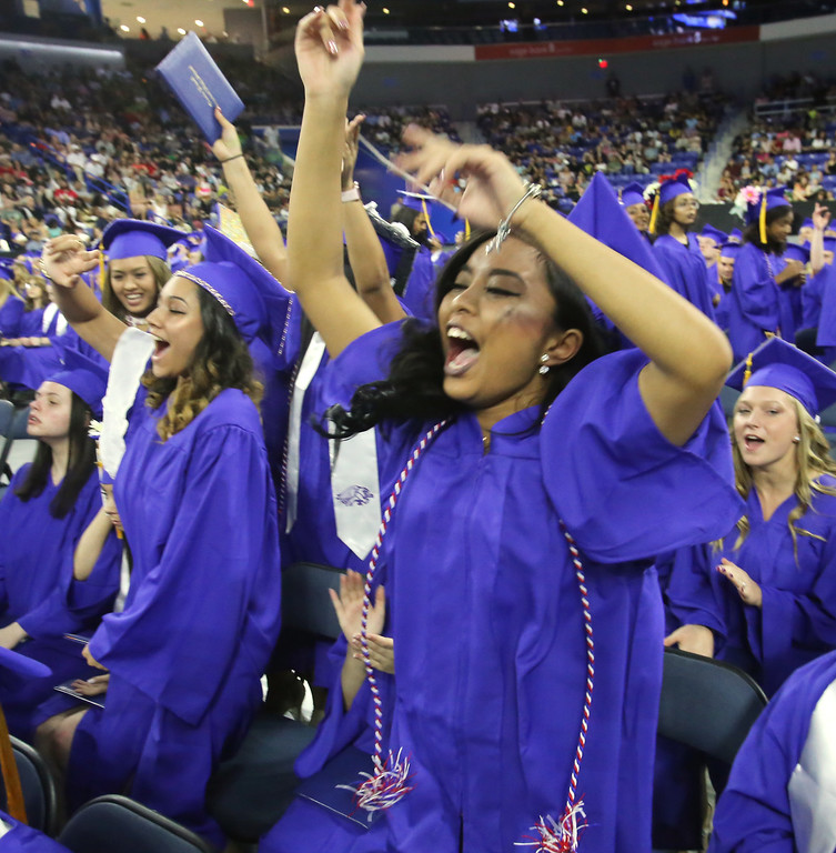. Greater Lowell Tech graduation. Natalie Dom of Lowell, right. (SUN/Julia Malakie)