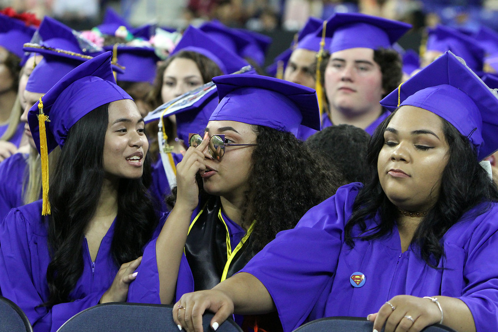 . Greater Lowell Tech graduation. From left, Angelica Savoeuth, Karyann Santos-Balbuena, and Gabriella Rosario, all of Lowell, and in Medical Laboratory & Assisting. (SUN/Julia Malakie)