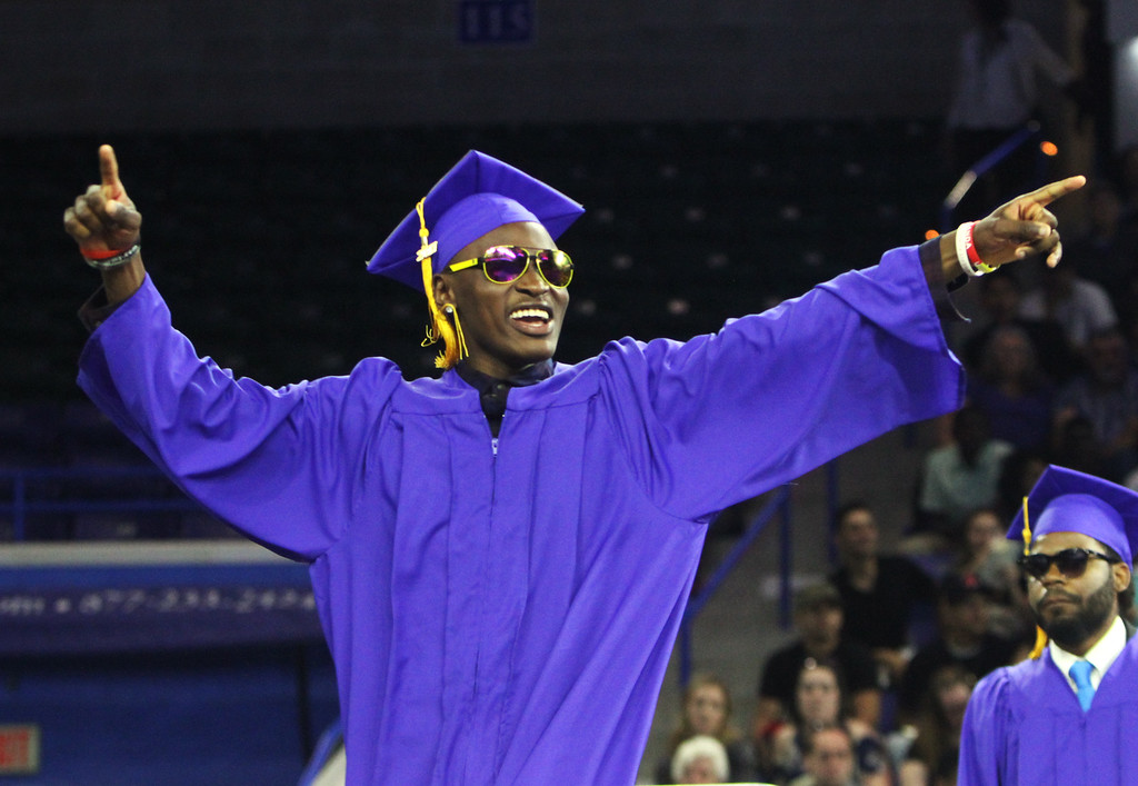 . Greater Lowell Tech graduation. Richard Sengendo Nsibambi of Lowell celebrates on his way up to get his diploma. (SUN/Julia Malakie)