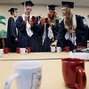 Record-Eagle/Keith King<br /> Peter Nelson, from left, Lanae Hanna and Sarah Grant sign mugs Friday, June 1, 2012 prior to the start of the commencement exercises at Grand Traverse Academy.