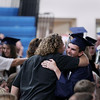 Record-Eagle/Keith King<br /> Caleb Lammers hugs his father, Scott Lammers, of Traverse City, Friday, June 1, 2012 during the commencement exercises at Grand Traverse Academy.