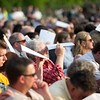 Audience members shield their eyes from the summer sun at Groton-Dunstable Regional High School's graduation on June 3, 2016. Nashoba Valley Voice/Chris Lisinski