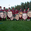 Members of Groton-Dunstable Regional High School's Class of 2016 who played on the hockey team together prepare to pose for a photo with cardboard cutouts of their faces — all made by parent Mike Cole — after graduation on June 3, 2016. From left to right: Carl Zimmon of Groton, Mike McDonough of Groton, Kyle Lacombe of Groton, Patrick Keating of Groton, Michael Cole of Groton, Robert Hoare of Dunstable, Ryan McLean of Groton, Darren Costa of Pepperell, John Langan of Groton and Harry Perrault of Groton. Nashoba Valley Voice/Chris Lisinski