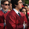 Groton-Dunstable graduation, at the high school. Brian McDermott of Groton stands for National Anthem. (SUN/Julia Malakie)