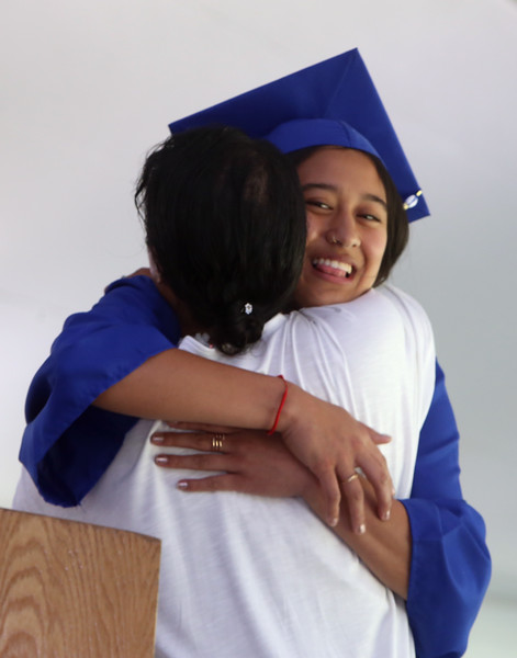 Innovation Academy Charter School graduation. Evelyn Sourn of Tyngsboro hugs science teacher Raksmey Derival, who told stories about her at diploma presentation. (SUN/Julia Malakie)