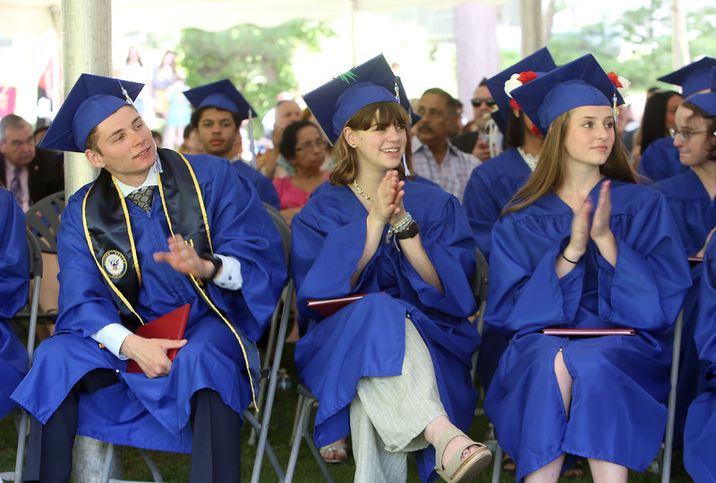 Innovation Academy Charter School graduation. From left, Jonathan Passarelli of Billerica, Peyton Ballam of Billerica, and Rachael Modeski of Dracut.(SUN/Julia Malakie)
