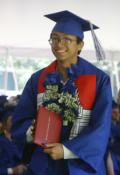 Innovation Academy Charter School graduation. Edward Ou of Lowell, who was one of two student speakers, with his diploma. (SUN/Julia Malakie)