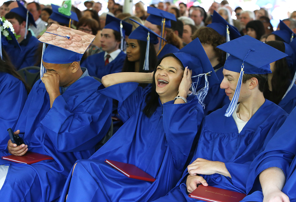 . Innovation Academy Charter School graduation. From left, Adrik Edmonds of Tewksbury, Kenializ Campos Hernandez of Lowell, and Lukas Pippos of Billerica. (SUN/Julia Malakie)