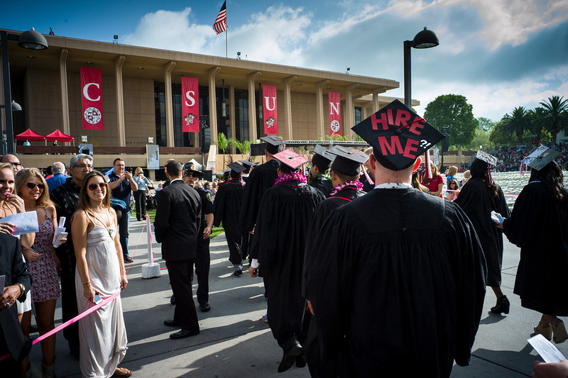 Description of . CSUN grads march onto the Oviatt Library lawn for  graduation ceremonies at Cal State Northridge Monday, May 19, 2014.  ( Photo by David Crane/Los Angeles Daily News )