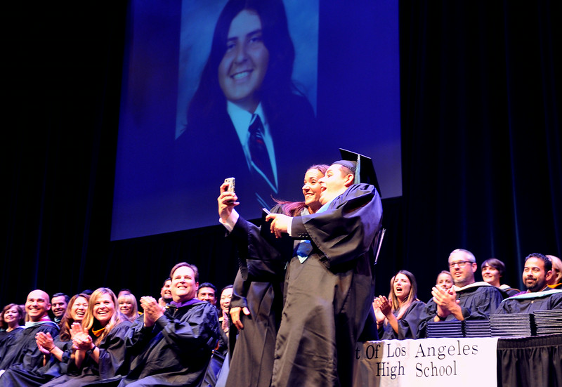 ". ""A graduate stops for a selfie as (POLA) Port of Los Angeles High School graduates its class of 2014 on Thursday night at the Long Beach Terrance Theater. Long Beach June 5, 2014. (Photo by Brittany Murray / Daily Breeze)\"""