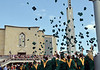 Lansdale Catholic graduates toss their caps into the air at the close of the commencement ceremony at the Shrine of Czestochowa in New Britain Township.   Tuesday, June 3, 2014.   Photo by Geoff Patton