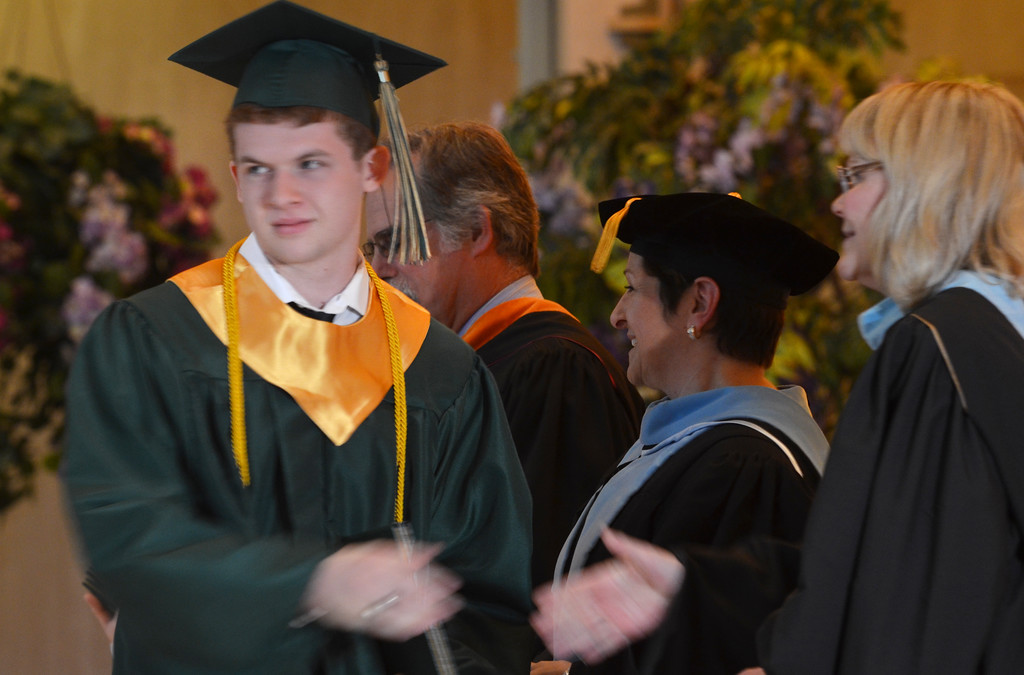 . James Paul Canfield receives his diploma at the Lansdale Catholic high school commencement ceremony.   Tuesday, June 3, 2014.  Photo by Geoff Patton