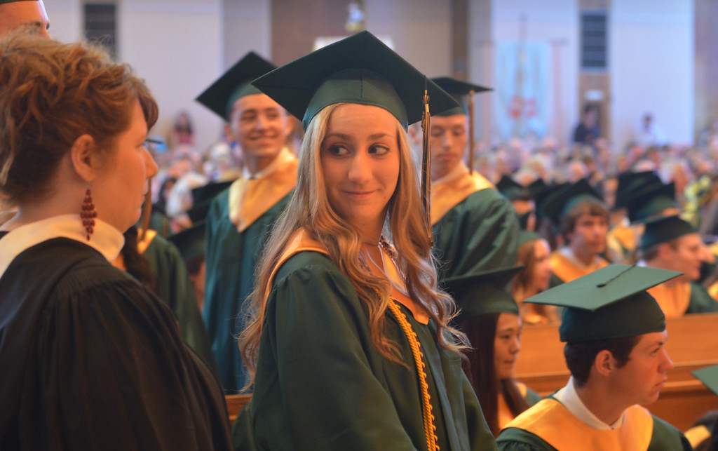 . Michele Christine Doheny waits for her name to be called to receive her diploma at the Lansdale Catholic high school commencement ceremony.   Tuesday, June 3, 2014.  Photo by Geoff Patton