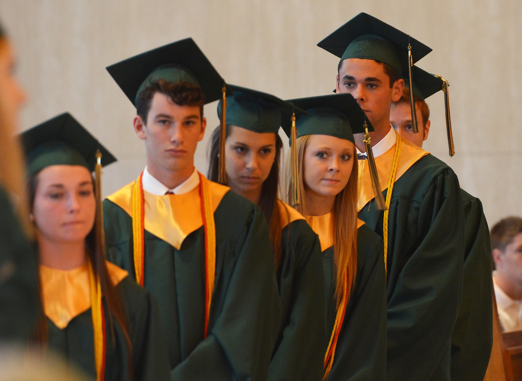 . Seniors stand as diplomas are conferred at the Lansdale Catholic high school commencement ceremony.   Tuesday, June 3, 2014.  Photo by Geoff Patton