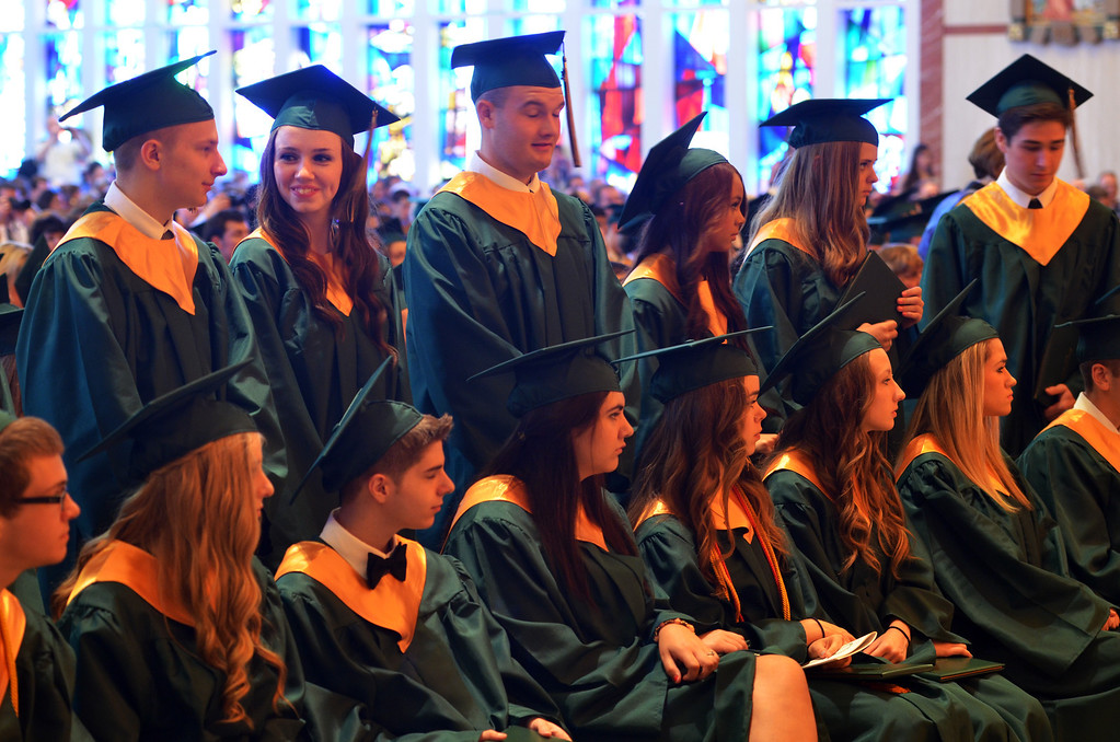 . Lansdale Catholic high school seniors stand as diplomas are conferred during the  commencement ceremony at the Shrine of Czestochowa.  Tuesday, June 3, 2014.  Photo by Geoff Patton