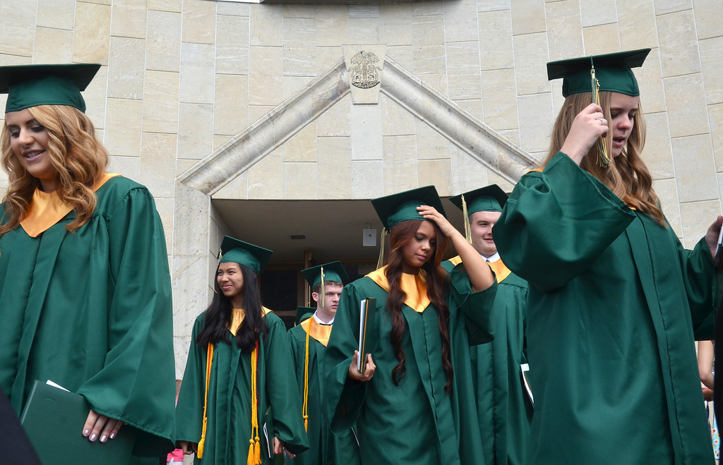 . Lansdale Catholic high school graduates walk toward the stairs at  the Shrine of Czestochowa following commencement ceremony.  Tuesday, June 3, 2014.  Photo by Geoff Patton