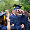 Lawrence Academy Senior Class President Joshua Garber, who hails from Bedford, enters the school's June 3, 2016 graduation ceremony in Groton wearing a pair of 2016-themed glasses. Nashoba Valley Voice/Chris Lisinski