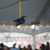 A hat hangs from the tent at Lawrence Academy's graduation on June 3 after the Class of 2016 threw their hats in celebration. Nashoba Valley Voice/Chris Lisinski