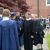 Following a longtime tradition, Rob Moore (center), Lawrence Academy's assistant head of school, shakes hands with a line of new graduates following the Class of 2016's graduation on June 3 in Groton. Nashoba Valley Voice/Chris Lisinski