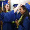 Littleton High School graduation, at the high school. Alexandra Shea, left, helps Gihanah Seb-Di Dio with her cap. (SUN/Julia Malakie)