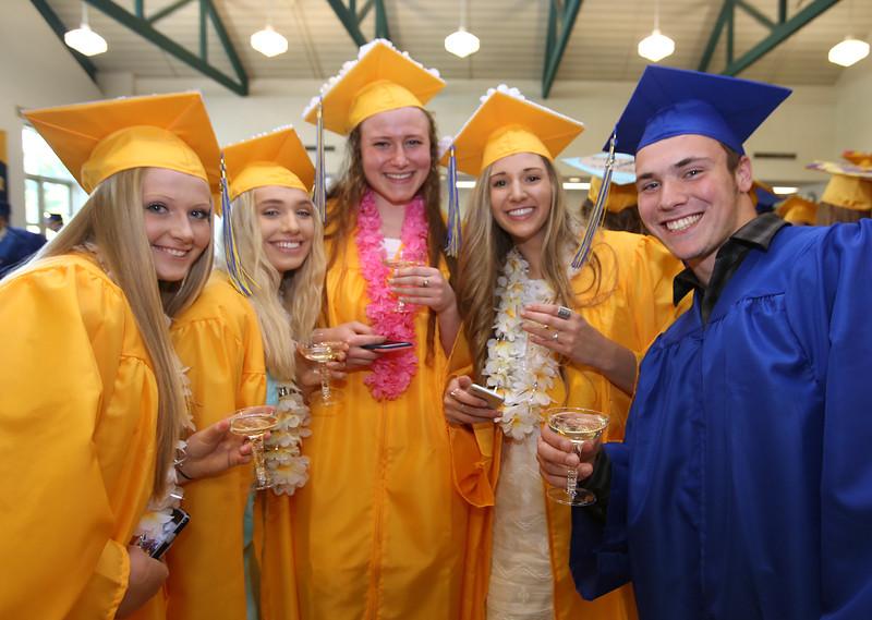 Littleton High School graduation, at the high school. From left, Shannon Riordan, Kayla Nixon, Elizabeth Portante, Sarah Smith and Sawyer Landfors, ready for the pre-graduation toast. (SUN/Julia Malakie)