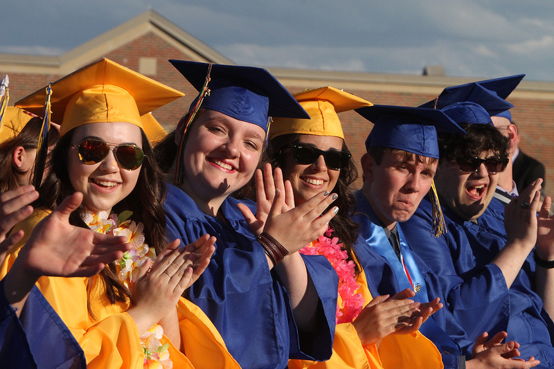 Littleton High School graduation, at the high school. From left, Emma Manning, Jenna Marcopul, Julia McCarthy, James McDonagh, and Eli Miller. (SUN/Julia Malakie)