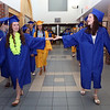 Littleton High School graduation. Alexandra Shea, left, and Rachel Higgens touch hands as the procession leaves the high school. (SUN/Julia Malakie)