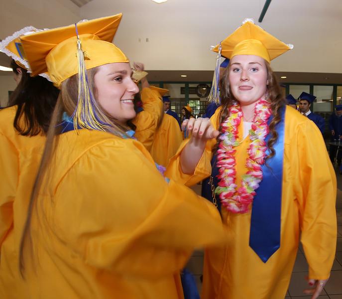 Littleton High School graduation, at the high school. Jill Gruskowski, left, and Brooke Gibbons. (SUN/Julia Malakie)