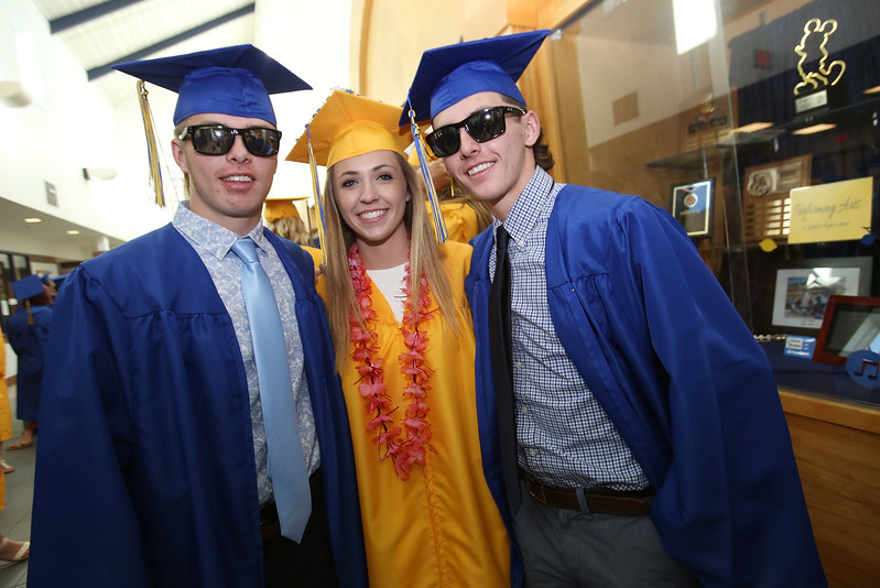 Littleton High School graduation, at the high school. Triplets Cam, Molly and Griffin Shoemaker of Shirley. (SUN/Julia Malakie)