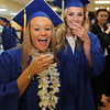 Littleton High School graduation at Alumni Field. Kristen Rebello, left, and Hayley Anderson and classmates toast with sparkling grape juice before graduation. (SUN/Julia Malakie)