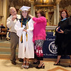 Lowell Catholic 27th Commencement Exercises. Brian and Colleen Curley of Dracut, parents of salutatorian Sam Curley, put on her medal. At right is principal Maryellen DeMarco. (SUN/Julia Malakie)