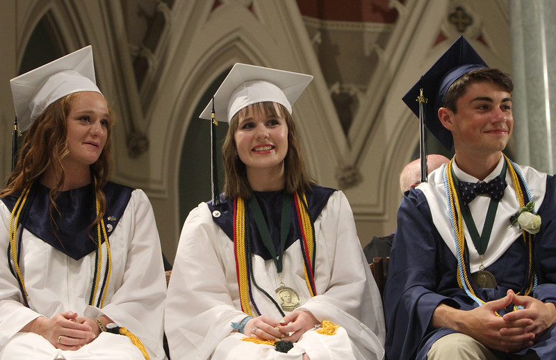 Lowell Catholic 27th Commencement Exercises. From left, Baylee Duarte of Pelham, N.H., salutatorian Sam Curley of Dracut, and valedictorian Alec DiCiaccio of Tewksbury. (SUN/Julia Malakie)