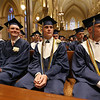 Lowell Catholic graduation at Immaculate Conception. From left, James Bartlett of Lowell, William Askenburg III of Chelmsford, and Mitchell Andrea and Michael Andrea of Pelham, N.H. (whose third triplet brother Matthew Andrea was St. Francis Xavier Award recipient). (SUN/Julia Malakie)