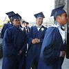 From left, Kevin Searth of Lowell, Jeremiah Martinez of Methuen, and Sean McCulllough of Tyngsboro, enter for Lowell Catholic graduation at Immaculate Conception. (SUN/Julia Malakie)