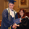 Lowell Catholic graduation at Immaculate Conception. James Burrill of Chelmsford receives diploma from principal Maryellen DeMarco. (SUN/Julia Malakie)