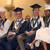 Lowell Catholic graduation at Immaculate Conception. From left, St. Francis of Assissi Award recipient Ellen McKenna of Lowell, St. Francis Xavier Award recipient Matthew Andrea of Pelham, N.H., salutatorian Anthony Grieco of Tewksbury, and valedictorian Susritha Kopparapu of Tyngsboro. (SUN/Julia Malakie)