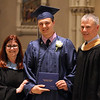 Lowell Catholic graduation at Immaculate Conception. Kyle Knight of Dracut receives his diploma from principla Maryellen DeMarco, and his father Stephen Knight, who works at the school (SUN/Julia Malakie)
