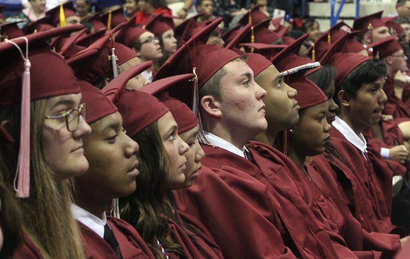 Lowell High School graduation. C House graduates listen to speeches. (SUN/Julia Malakie)