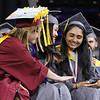 Lowell High graduation. From left, valedictorian Emily Satterfield and salutatorian Pechthida Kim reassure Jahnvi Patel, who became emotional after receiving her Carney Medal. (SUN/Julia Malakie)