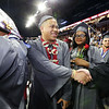 Lowell High graduation. Capone Phouvong, center, and Lucienne Pierre, enter arena. (SUN/Julia Malakie)