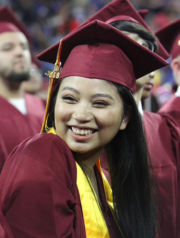 . Lowell High graduation. Tiffany Leng smiles toward audience as graduates march in. (SUN/Julia Malakie)