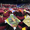 Lowell High graduation.  Patel Messages on caps of Heer Patel, left, and Kruti Patel (no relation). (SUN/Julia Malakie)