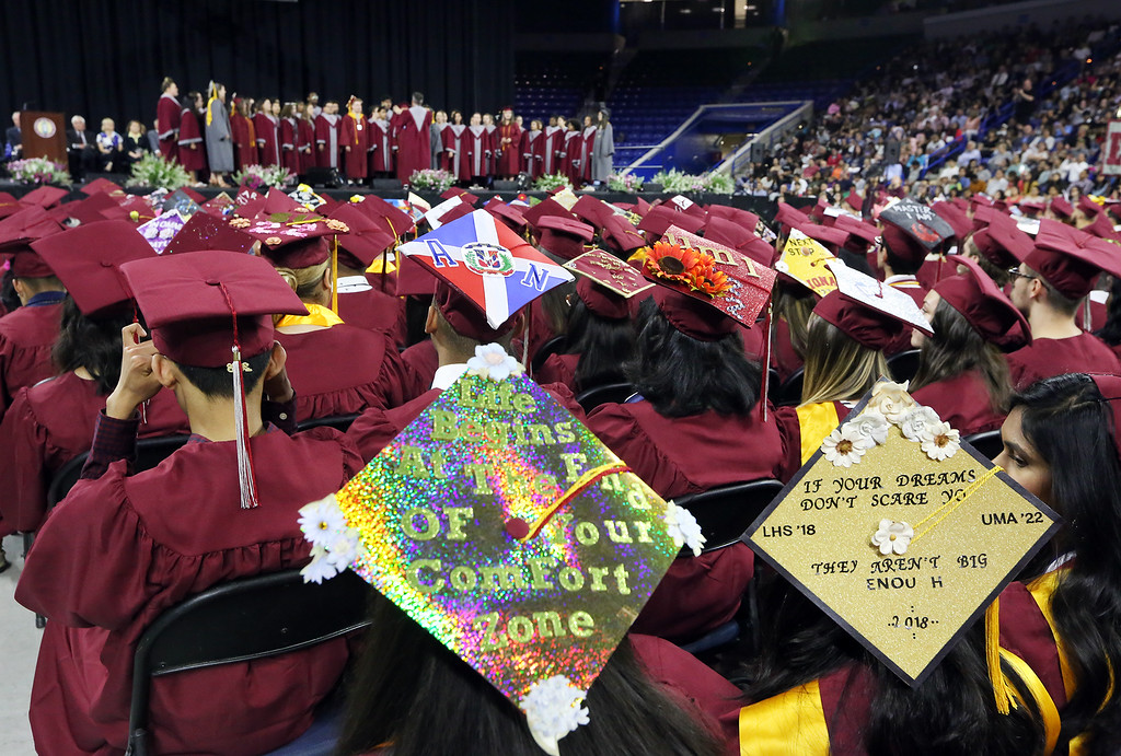 . Lowell High graduation.  Patel Messages on caps of Heer Patel, left, and Kruti Patel (no relation). (SUN/Julia Malakie)