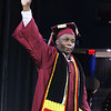 Lowell High graduation. Class president Phillip Sekayi holds up his diploma.(SUN/Julia Malakie)