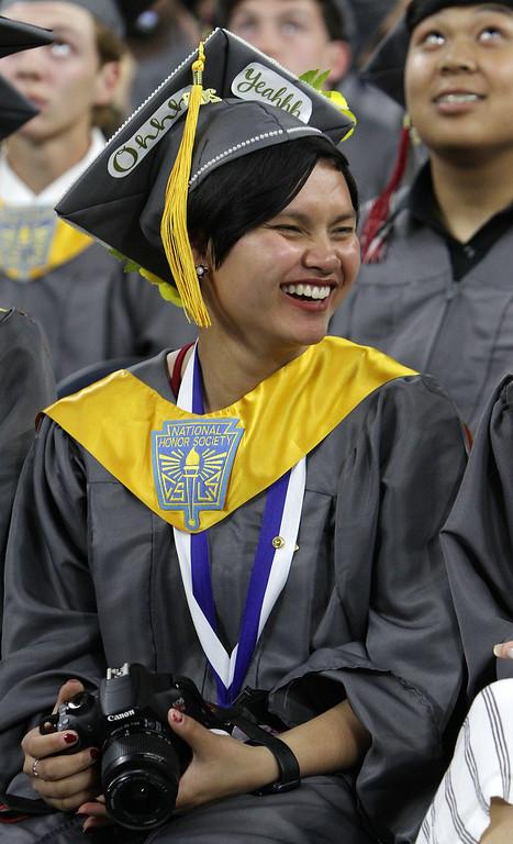 . Lowell High graduation. Sarah Boutselis with camera. (SUN/Julia Malakie)