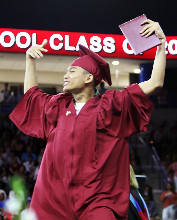 . Lowell High graduation. Benjamin Koeun celebrates. (SUN/Julia Malakie)