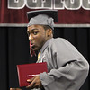 Lowell High graduation. Marcell Richardson does a little dance across the stage. (SUN/Julia Malakie)