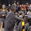 Lowell High graduation. Catherine Moynihan and Prince Moye return with diplomas. (SUN/Julia Malakie)