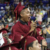 Lowell High graduation. Kyle Choum cheers friends. (SUN/Julia Malakie)